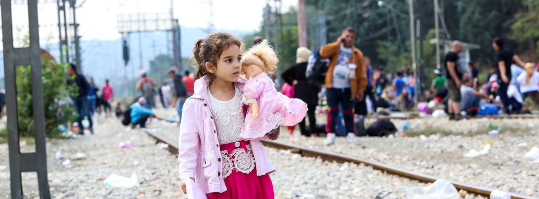 Little girl with doll Syrian refugee