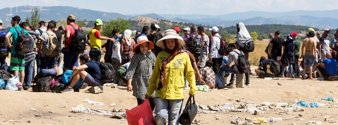 Walking women fleeing Syria